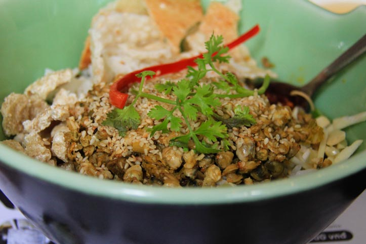 baby clams or mussels in com hen, a vietnamese dish